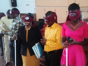 Church attendants blindfolded during the event